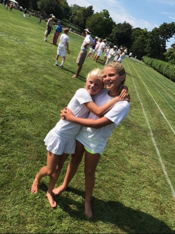 Willa Ball and Linden Frelinghuysen share a hug at Field Day.