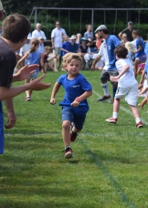 Wildcat Gus O'Callaghan, a student at the Quogue School, takes off in the Monster Relay.