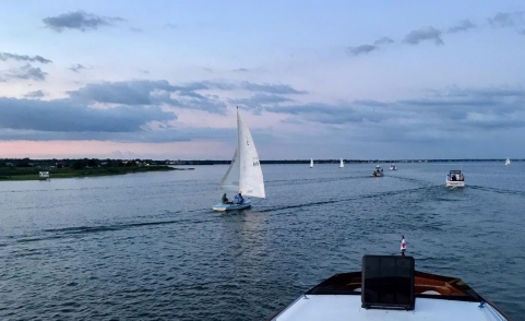 Sunset smiled on the start of the Moonlight Sail on August 5 as skippers guided their vessels out of Penniman's Creek. --Suzanne Lightbourn Photo